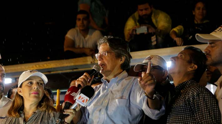 Ecuadorean presidential candidate Guillermo Lasso gives a speech to supporters near the Electoral National Council (CNE) after the presidential election in Guayaquil